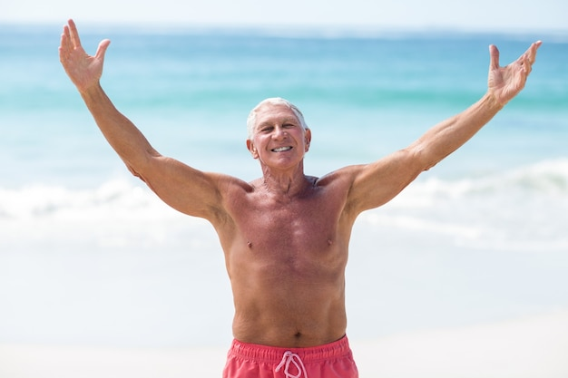 Handsome mature man outstretching his arms