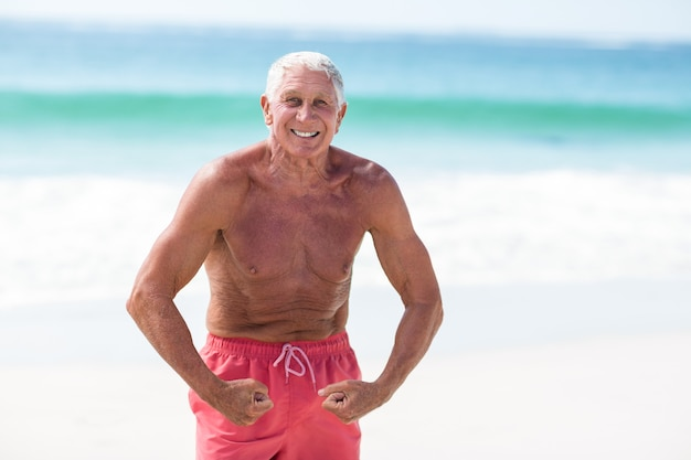 Handsome mature man showing his muscles