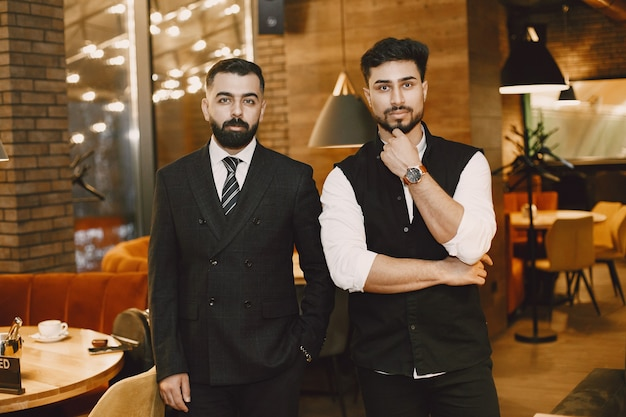 Handsome men in a restaurant