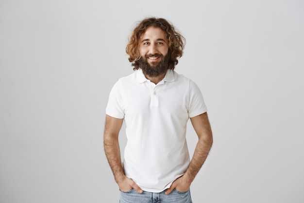 Handsome middle-eastern bearded man smiling friendly