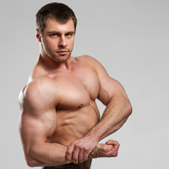 Handsome muscular guy with naked torso