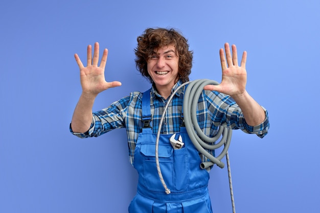 Handsome optimistic plumber man