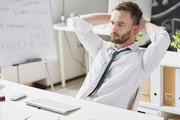 Handsome pensive businessman at desk