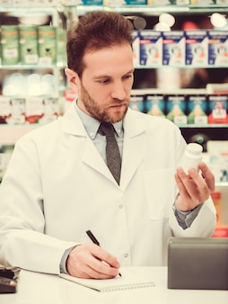 Handsome pharmacist at work