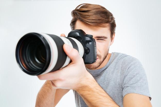 Handsome photographer making shot on photo camera