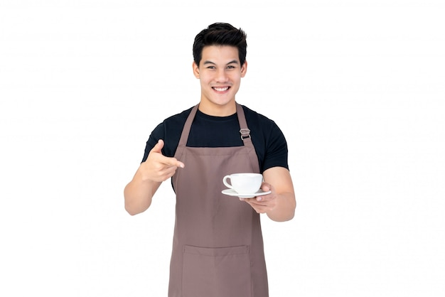 Handsome smiling asian barista serving coffee studio shot isolated on white background