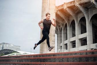 Handsome Sport man running at outdoor city