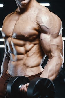 Handsome strong athletic men pumping up muscles workout barbell curl bodybuilding concept