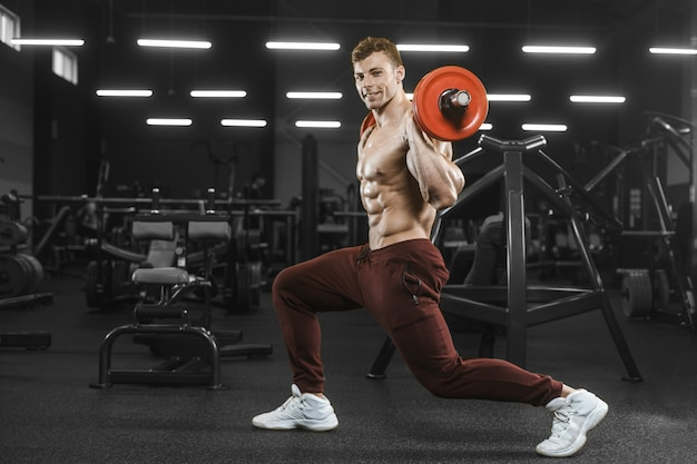 Handsome strong athletic men pumping up muscles workout barbell squat bodybuilding concept
