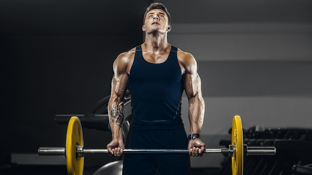Handsome strong athletic men pumping up muscles workout fitness and bodybuilding concept