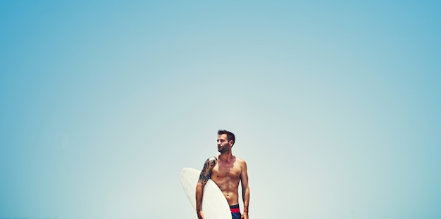 Handsome surfer at the beach