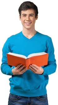 Handsome teenager with book isolated on white background