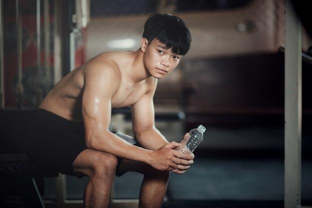 Handsome training equipment at sport gym