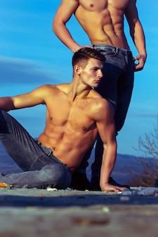 Handsome twin men or bodybuilders