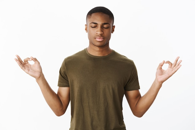 Handsome young african-american with khaki tshirt