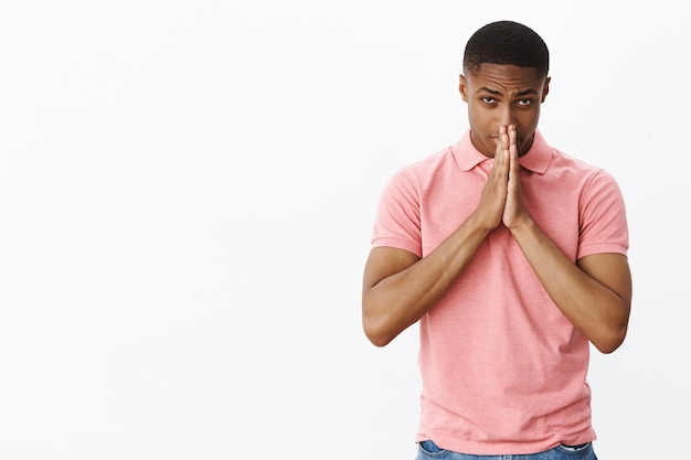 Handsome young african-american with pink polo tshirt