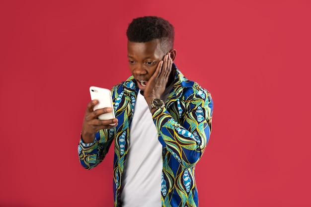 Handsome young african man in shirt with phone