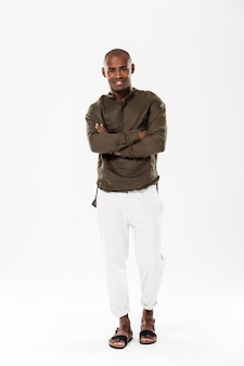 Handsome young african man standing isolated
