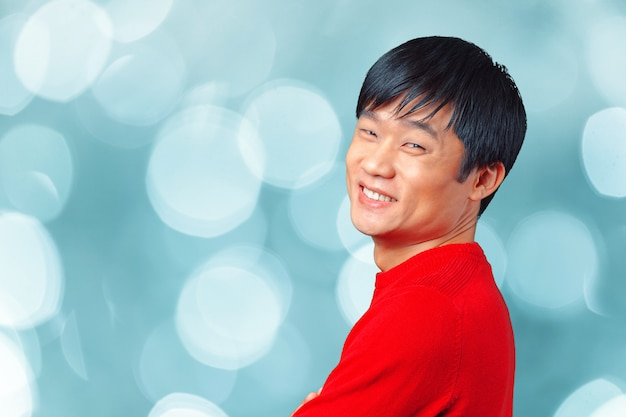 Handsome young asian man smiling