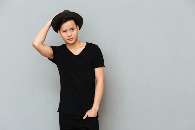 Handsome young asian man standing