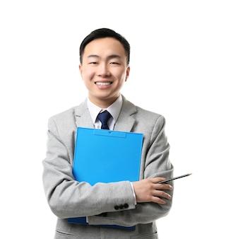 白い背景の上のハンサムな若いアジアの先生