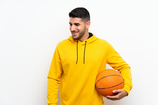 Handsome young basketball player man over isolated white wall smiling a lot