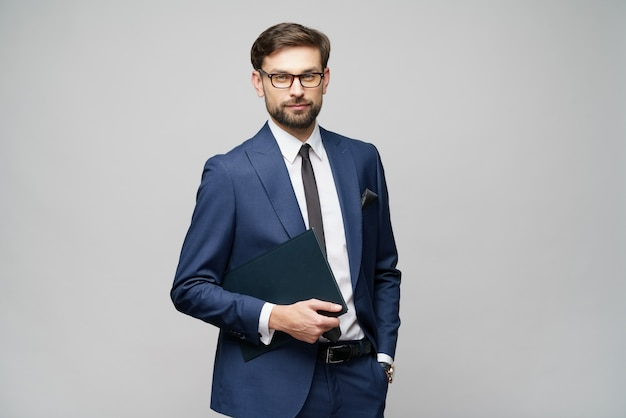 Handsome young business man holding document folder