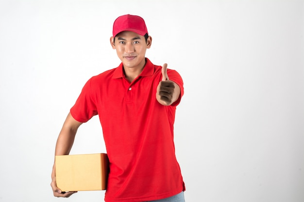 Handsome young delivery man with box isolated on white background.