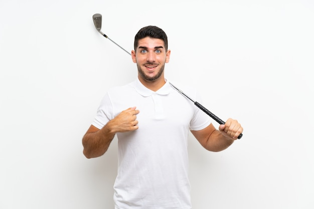 Handsome young golfer player man over isolated white  with surprise facial expression