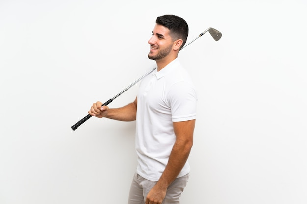 Handsome young golfer player man over isolated white