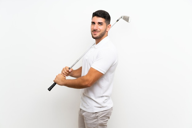 Handsome young golfer player man  on white