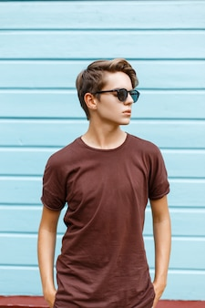 Handsome young guy with the hairstyle in sunglasses
