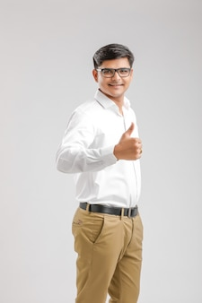 Handsome young indian man showing thumps up isolated