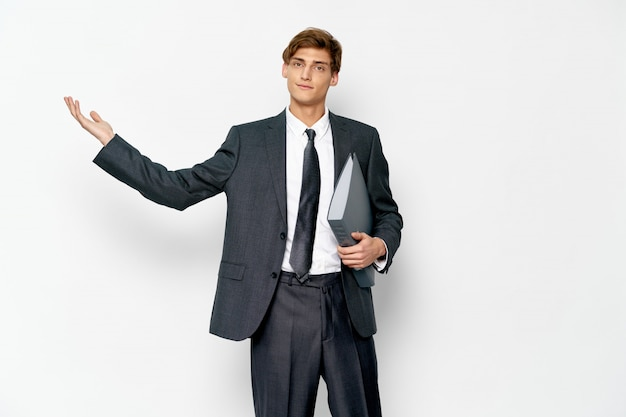 Handsome young male model in a stylish suit posing in the studio