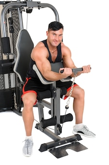 Handsome young man doing lateral pull-down workout isolated on white