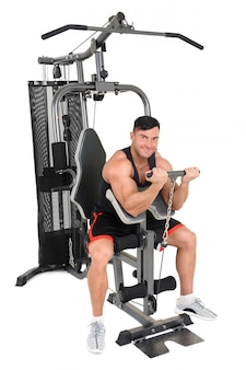 Handsome young man doing lateral pull-down workout isolated