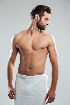 Handsome young man dressed in towel