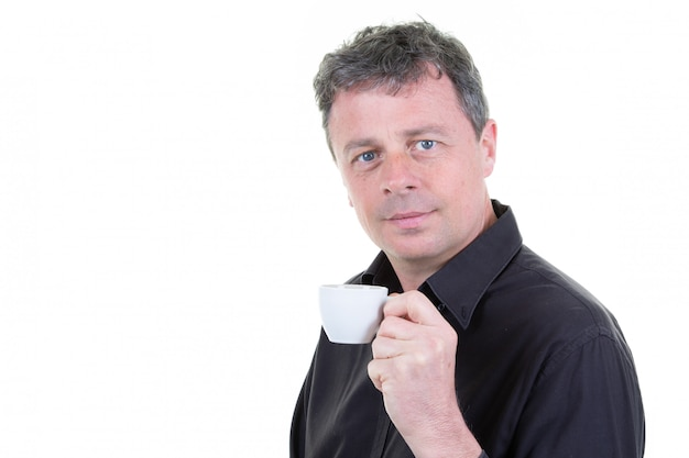 Handsome young man enjoying aroma drinking cup coffee