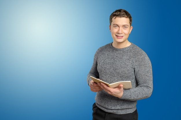 Handsome young man holding book