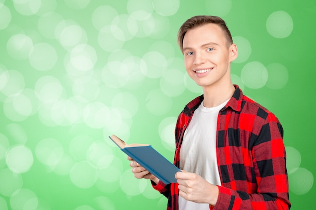 Handsome young man holding books