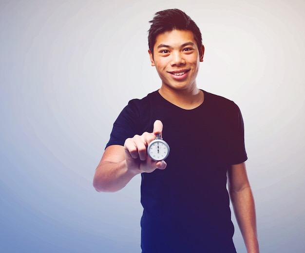 Handsome young man showing a chronometer