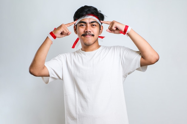 Handsome young man wearing casual shirt smiling pointing to head with both hands finger, great idea or thought, good memory over white background