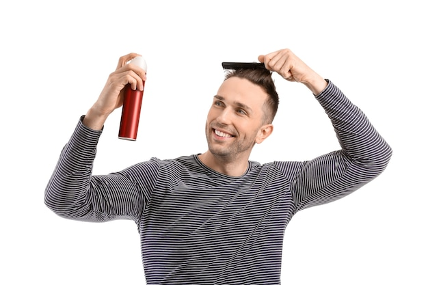 Handsome young man with hair spray isolated