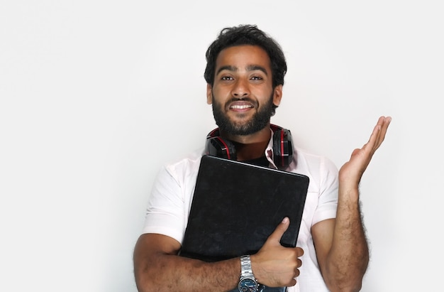 Handsome young man with laptop on white background