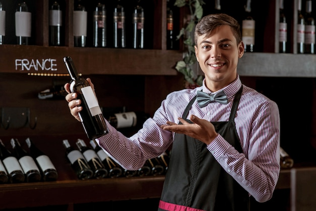 Handsome young sommelier at the wine shop