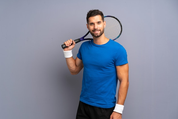 Handsome young tennis player man