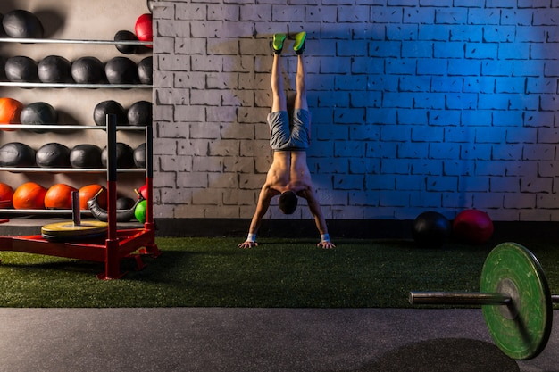 Handstand push-up man workout at gym
