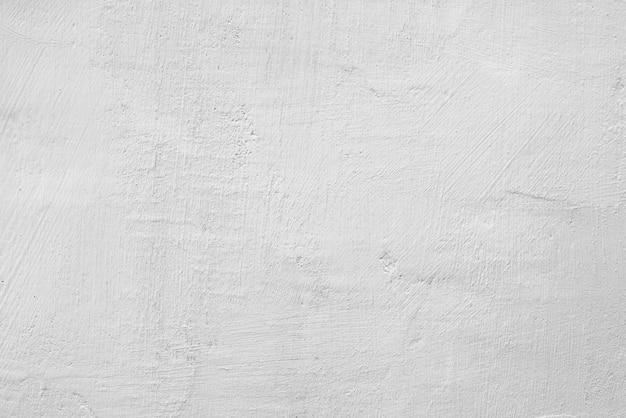 手仕事石膏アプリケーション。抽象的な白い背景。白い漆喰の質感。白い粗い表面。