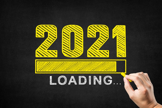Handwriting 2021 on blackboard, welcome to 2021
