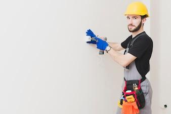 Handyman installing a plug